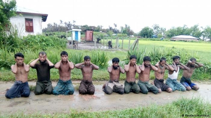 Ten Muslim Rohingya men in the village of Inn Din