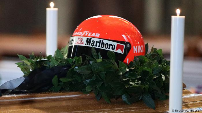 A racing helmet sits on Niki Lauda's casket at a memorial service in Vienna