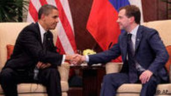 President Barack Obama shaking hands with Russia's President Dmitry Medvedev