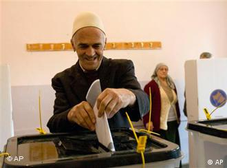An elderly ethnic Albanian man casts his ballot in Kosovo's first elections