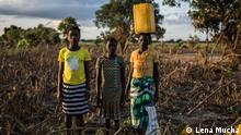Elisabeth Moises 13, Victoria Jaime 14 and Amelia Daute 38 are standing in a corn field destroyed by the flooding that came after cyclone Idai in Grudja, District Buzi, Mozambique Many of the people found refugee on the roof of the local school, where they stayed 3 days waiting for the water level falling. 14 habitants of Grudja died, 9 of them were children.