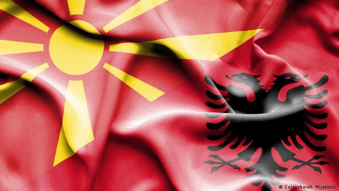 Waving flag of Albania and Macedonia
