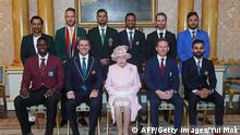 Britain's Queen Elizabeth II (C) poses with the captains of the cricket teams participating in the ICC Cricket World Cup 2019, in the 1844 Room at Buckingham Palace, London on May 29, 2019, ahead of the competition's Opening Party on the Mall. - (L-R) Back row: Pakistan's captain Sarfaraz Ahmed, South Africa's captain Faf du Plessis, Bangladesh's captain Mashrafe Mortaza, Sri Lanka's captain Dimuth Karunaratne, New Zealand's captain Kane Williamson, Afghanistan's captain Gulbadin Naib. Front row: West Indies' captain Jason Holder, Australia's captain Aaron Finch Britain's Queen Elizabeth II, England's captain Eoin Morgan, India's captain Virat Kohli (Photo by Yui Mok / POOL / AFP) (Photo credit should read YUI MOK/AFP/Getty Images)