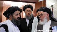 عکس از آرشیف: اعضای دفتر سیاسی طالبان به شمول ملا عبدالغنی برادر (سمت چپ)