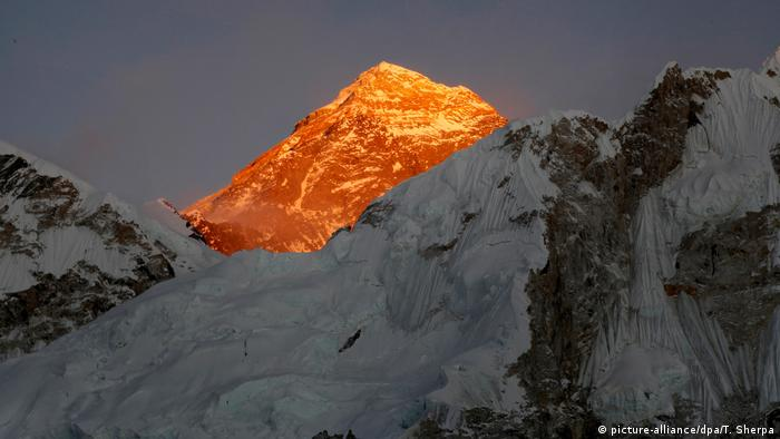 Himalayan mountains, with Mount Everest lit up by the sun