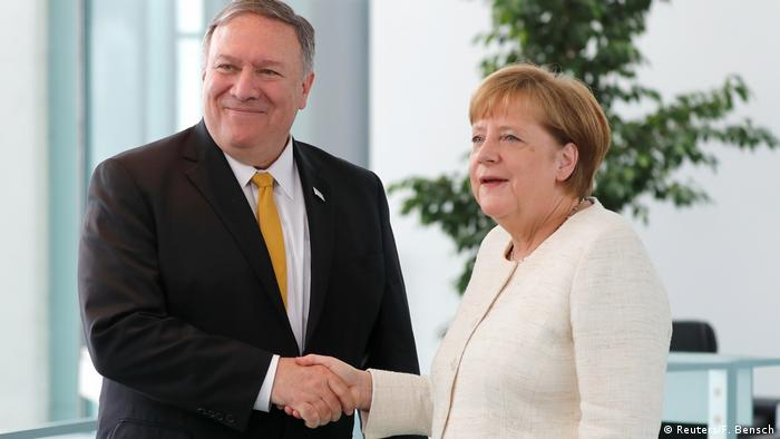 Mike Pompeo and Angela Merkel shake hands (Reuters/F. Bensch)