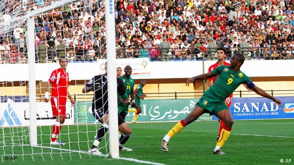 Cameroon's Eto'o Fils Samuel, right, scores against Morocco's goalkeeper Nadir Lamyaghri during their World Cup qualifying soccer match in Fez, Morocco, Saturday Nov. 14, 2009. Cameroon won the match 2-0.