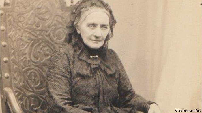 Clara Schumann as an old woman in a black brocade dress