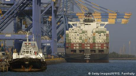 A container ship docked at India's Adani Port Special Economic Zone (APSEZ) in Mundra