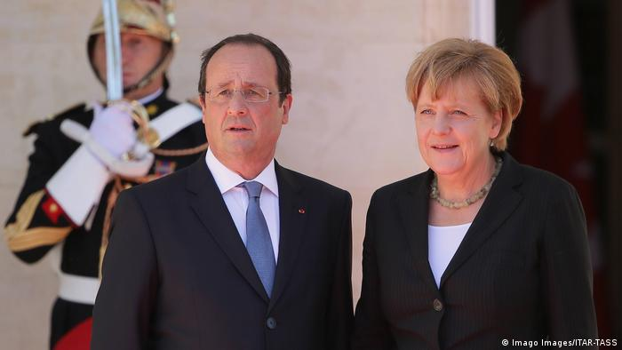 French President Francois Hollande (L) welcomes German Chancellor Angela Merkel at Benouville Castle (Chateau de Benouville) ahead of the celebrations marking the 70th anniversary of the Allied Forces D-Day landings in Normandy.
