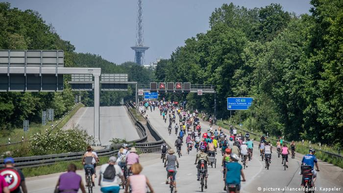 Cyclists ride on a Berlin motorway