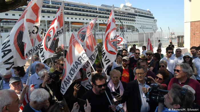 Members of No grandi navi - No big ships movement protest in front of the MSC Opera cruise ship that early in the morning crashed against a smaller tourist boat at the San Basilio dock in Venice, Italy