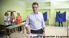 Greek opposition New Democracy party leader Kyriakos Mitsotakis casts his ballot for the European parliamentary elections, in Athens on May 26, 2019. (Photo by Michalis KARAGIANNIS / Eurokinissi / AFP) / The erroneous mention[s] appearing in the metadata of this photo by Angelos Tzortzinis has been modified in AFP systems in the following manner: [Michalis Karagiannis] instead of [Angelos Tzortzinis]. Please immediately remove the erroneous mention[s] from all your online services and delete it (them) from your servers. If you have been authorized by AFP to distribute it (them) to third parties, please ensure that the same actions are carried out by them. Failure to promptly comply with these instructions will entail liability on your part for any continued or post notification usage. Therefore we thank you very much for all your attention and prompt action. We are sorry for the inconvenience this notification may cause and remain at your disposal for any further information you may require. (Photo credit should read MICHALIS KARAGIANNIS/AFP/Getty Images)