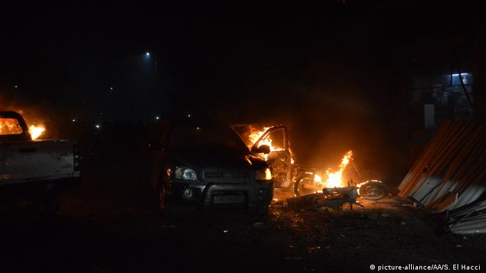A damaged car starts burning after a terrorist attack with a bomb-laden vehicle in the Syrian town of Azez on June 2, 2019