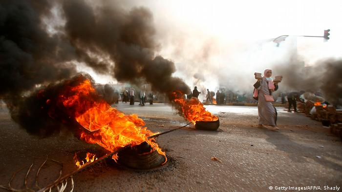 Burning tires at protests in Khartoum