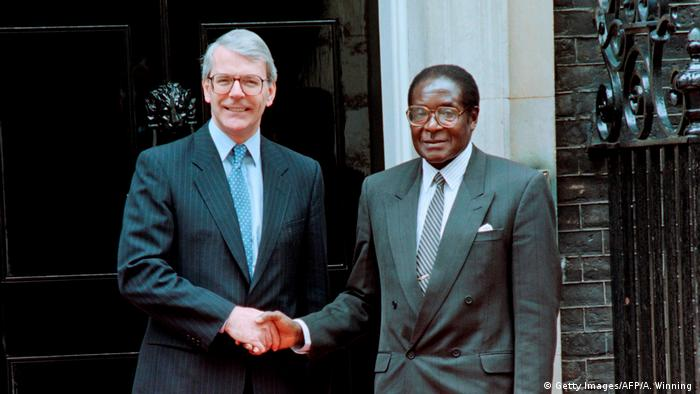 Zimbabwe's Robert Mugabe shakes hands with Prime Minister John Major outside 10 Downing Street, London, May 18, 1994. (Getty Images/AFP/A. Winning )