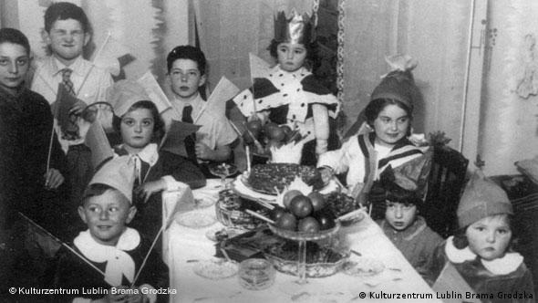 A black and white photo of Henio's family and friends at his birthday party