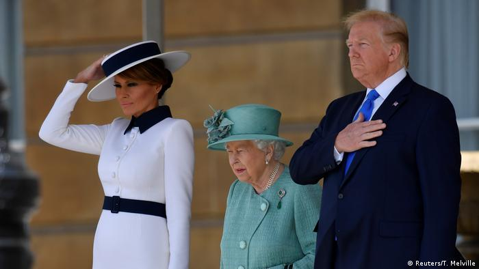 Donald and Melania Trump standing with the Queen (Reuters/T. Melville)