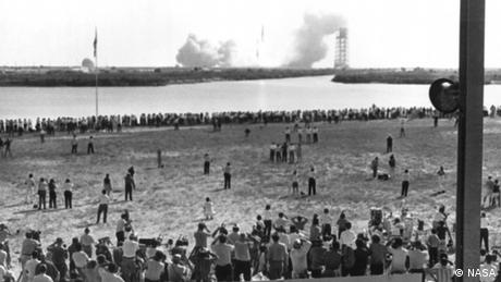 Thousands of news reporters watch Apollo 11 launch.