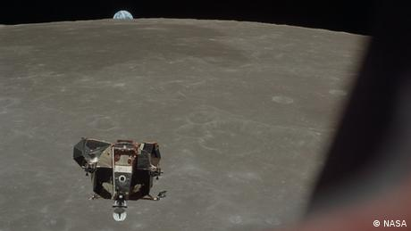 The Apollo 11 Lunar Module with moon and earth in the background.