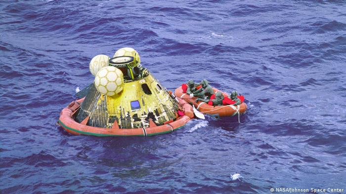 Apollo 11 crew in a boat before salvage.