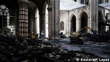 15.05.2019 *** Workers stand in the middle of rubbles and damages during the preliminary work in the Notre-Dame Cathedral one month after it sustained major fire damage in Paris, France May 15, 2019. Philippe Lopez/Pool via REUTERS