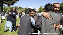 Men hug each other after offering Eid al-Fitr prayers at the presidential palace in Kabul, Afghanistan, Tuesday, June 4, 2019. Eid al-Fitr prayer marks the end of the holy fasting month of Ramadan in Afghanistan. (AP Photo/Rahmat Gul) |