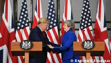 04.06.2019 *** British Prime Minister Theresa May and U.S. President Donald Trump shake hands during their joint news conference at the Foreign & Commonwealth Office, in London, Britain June 4, 2019. Stefan Rousseau/Pool via REUTERS