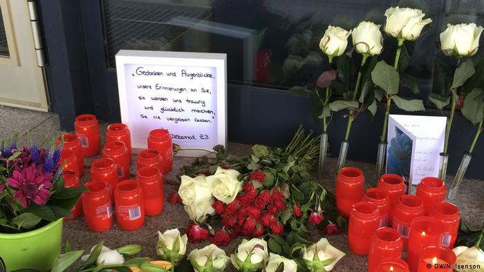Candles and flowers in front of the entrance to the office where Lübcke worked