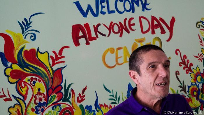 A man addressing a refugee day center