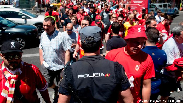 Spanish police and Liverpool fans before the game