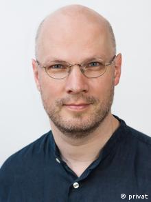 Профессор Мартин Ауст