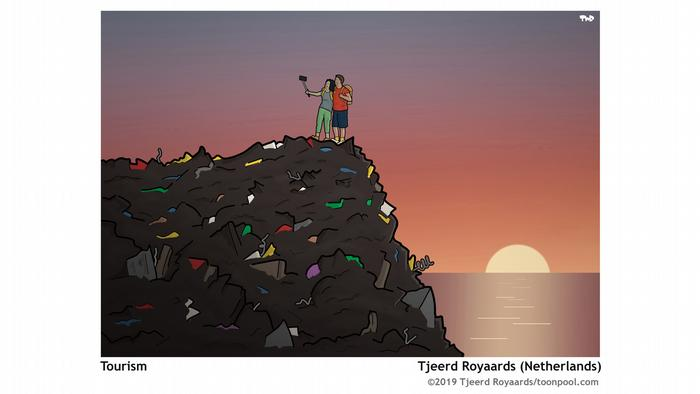 A couple standing on a mountain of trash, taking a selfie in front of a sunset over the ocean (Image: Tjeerd Royaards)