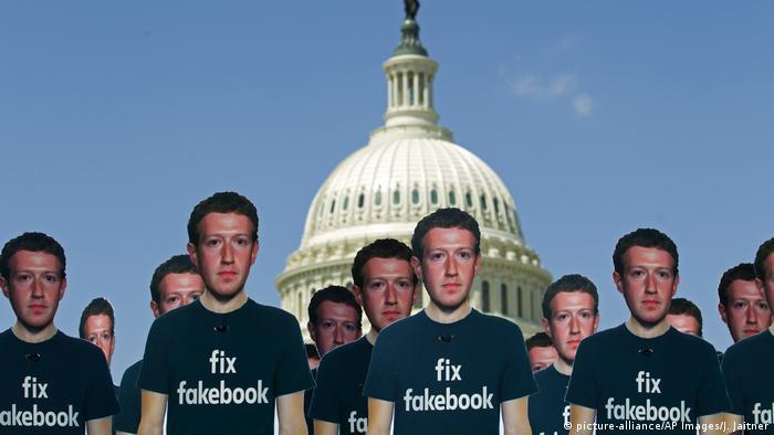 Life-sized cutouts depicting Facebook CEO Mark Zuckerberg