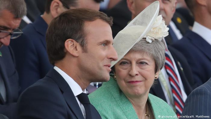 Emmanuel Macron y Theresa May.