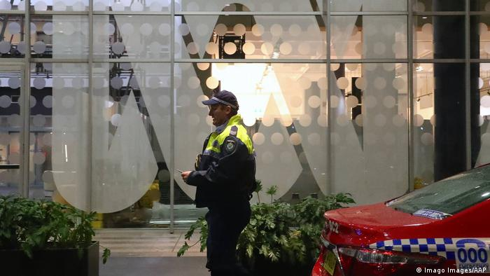 A police officer stands outside the ABC (Australian Broadcasting Corporation) building in Sydney