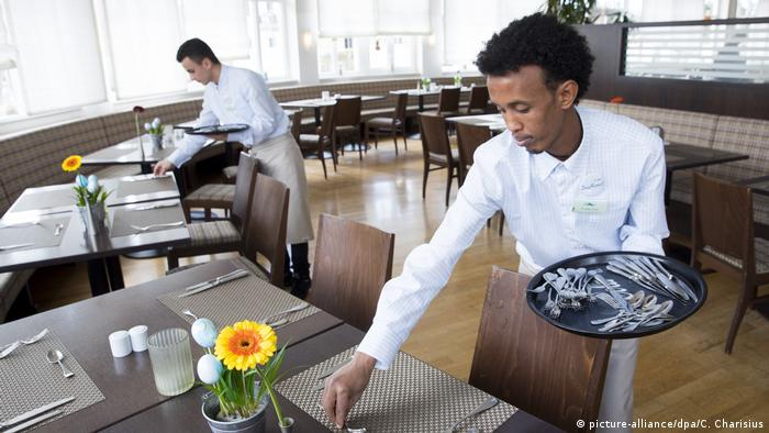 Two migrants work at a restaurant in Rantum, northern Germany