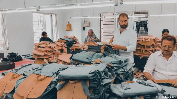 Indian employees producing backpacks and bags for Fitz & Huxley