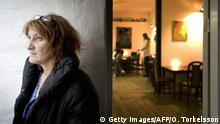 Copenhagen, DENMARK: TO GO WITH AFP STORY- Jannie Petersen, 52, manager of the Hotellet stands in the entrance of the Hotel in Copenhagen, 09 January 2007. The Hotellet is a hotel in Copenhagen where the employees are recovering drug addicts, alcoholics and others with social problems who have found not only a job but a purpose in life. AFP PHOTO / OLA TORKELSSON (Photo credit should read OLA TORKELSSON/AFP/Getty Images)