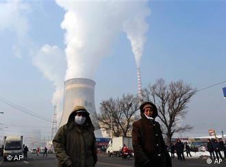 A coal fired power plant in china emits billowing smoke