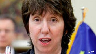 Catherine Ashton with an EU flag to the right just in front of her