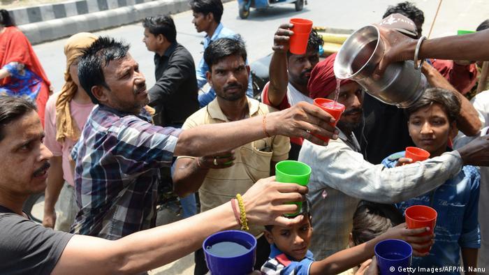 Volunteers distribute water in India