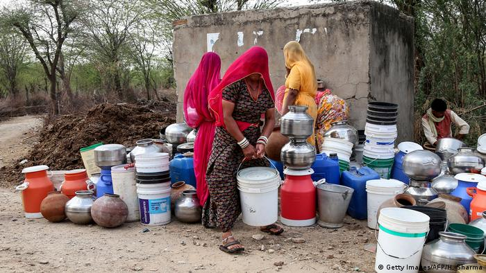 Women collect water during a heat wave in India (Getty Images/AFP/H. Sharma)