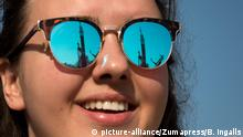 September 10, 2017 - Baikonur, Kazakhstan - The Soyuz rocket is seen reflected in the glasses of a young woman as it is lifted into launch position at the Baikonur Cosmodrome September 10, 2017 in Baikonur, Kazakhstan. International Space Station Expedition 53 crew American astronaut Mark Vande Hei of NASA, Soyuz Commander Alexander Misurkin of Roscosmos, and American astronaut Joe Acaba of NASA will launch aboard the rocket on September 13th |