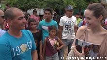 Special envoy for the United Nations High Commissioner for Refugees Angelina Jolie speaks to people in Riohacha, Colombia June 7, 2019. Picture taken June 7, 2019. Courtesy of UNHCR/Alexander St Denis/Handout via REUTERS ATTENTION EDITORS - THIS IMAGE WAS PROVIDED BY A THIRD PARTY. NO RESALES. NO ARCHIVES. MANDATORY CREDIT