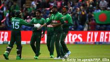 Bangladesh's captain Mashrafe Mortaza (C) celebrates with teammates after taking a catch to dismiss England's Jason Roy during the 2019 Cricket World Cup group stage match between England and Bangladesh at Sophia Gardens stadium in Cardiff, south Wales, on June 8, 2019. (Photo by Paul ELLIS / AFP) / RESTRICTED TO EDITORIAL USE (Photo credit should read PAUL ELLIS/AFP/Getty Images)