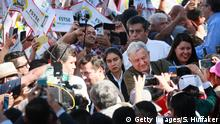 June 8, 2019*** TIJUANA, MEXICO - JUNE 08: Mexican President Andres Manuel Lopez Obrador shakes hands with the crowdduring a unity rally on June 8, 2019 in Tijuana, Mexico.. Lopez Obrador committed to defending Mexicos dignity amid a looming threat from U.S. President Donald Trump, who has pledged to impose 5% tariffs on Mexican products unless the country prevents Central American migrants from traveling through its territory.(Photo by Sandy Huffaker/Getty Images)
