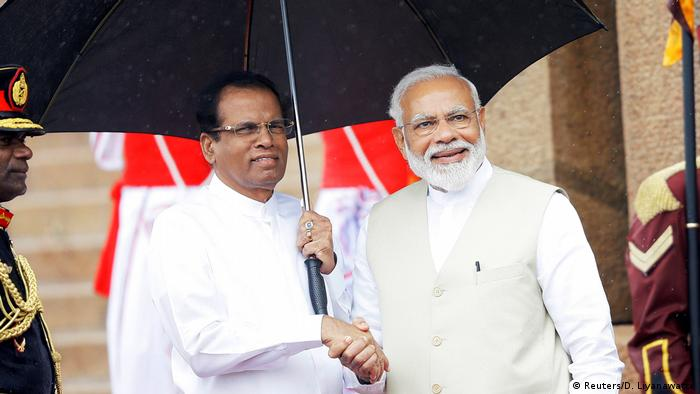 India's Prime Minister Narendra Modi shakes hands with Sri Lanka's President Maithripala Sirisena during his welcome ceremony in Colombo