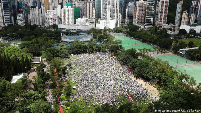 Protesters gather in a park ahead of a rally through the streets (Getty Images/AFP/D. de la Rey)