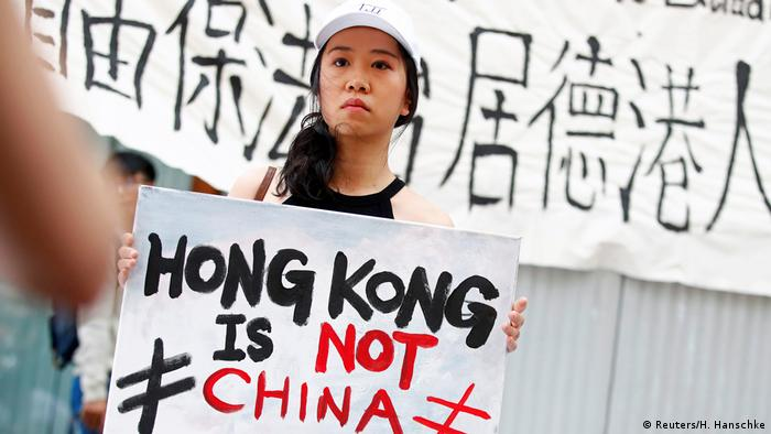 Protestor with a placard reading Hong Kong is not China